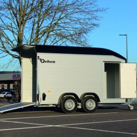 dual axle box trailer with rear door / ramp down and side door open